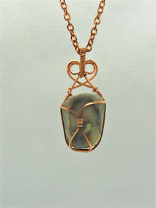 Infinite Stone Pendant, wrapped in copper wire with a double looped heart design.