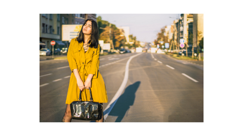 Woman in Yellow Dress Standing in the Road