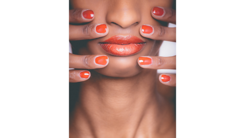 Nails and lips of a woman