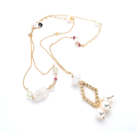 Textured gold, diamond shaped pendant with 3 white pearls, delicate long chain with scattered semi-precious stones