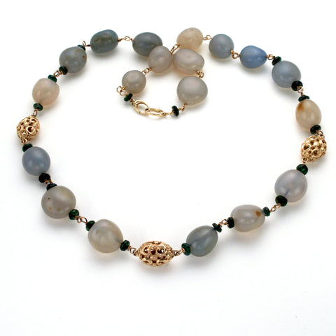 Classic necklace with smooth oval greenish blue stones, small faceted green tourmaline and hand carved gold oval beads