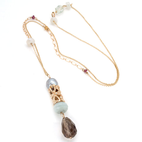 Sculptural gold bead featuring hearts, gray pearl, smokey quartz, and milky aquamarine on delicate chain with tiny accent stones