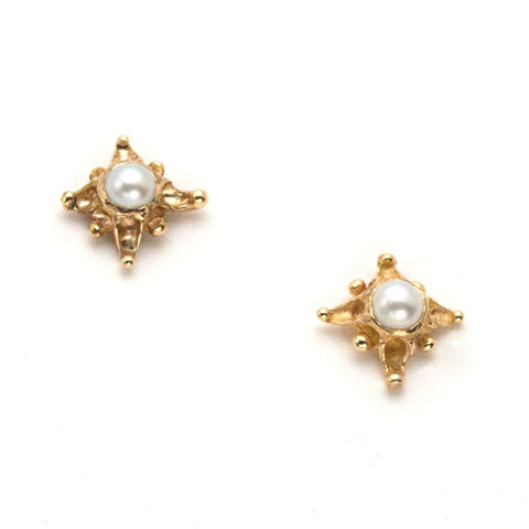Tiny 14 karat gold post earrings, star design with white pearl center