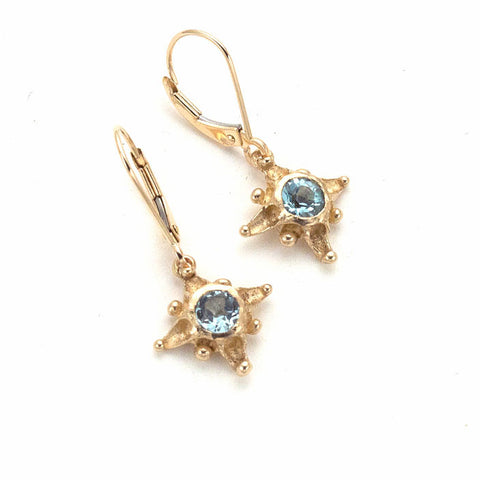 Tiny 14 karat gold star drop earrings with Sky blue topaz center