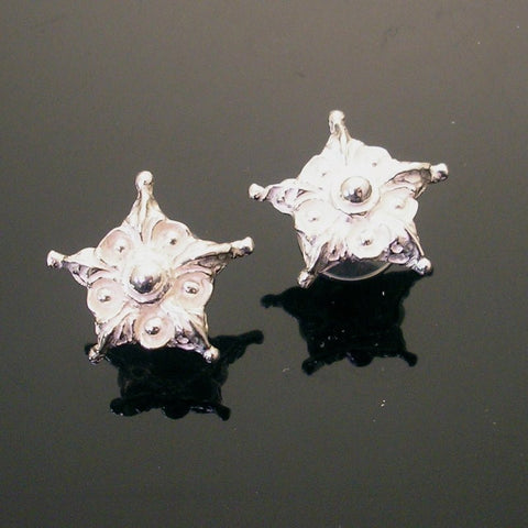 Hand sculpted sterling silver post earring with floral star motif