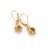Handmade delicate gold earring with faceted citrine stones in center