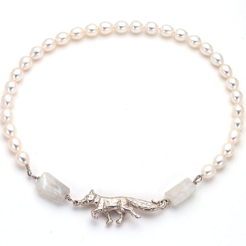 hand carved by anna biggs in wilmington delawarefox clasp, fresh water pearl