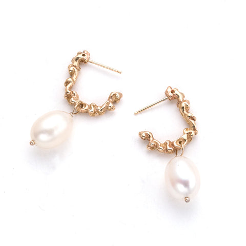 half hoop earrings in textured gold with white pearl drop