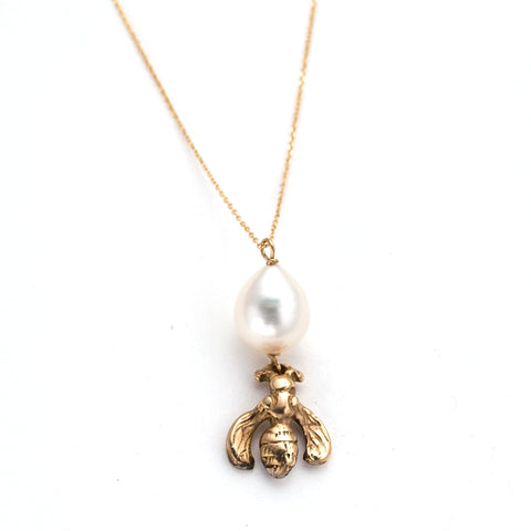 hand carved gold bumblebee charm on delicate gold chain with white pearl accents