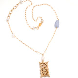 Gold filigree handmade rectangular pendant on long gold chain interspersed with semi-precious stones