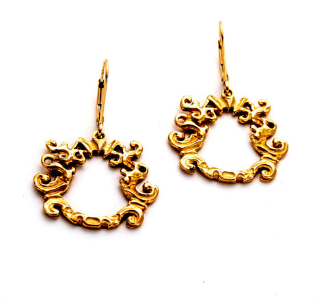 Textural gold, open circle design of sculpted waves, hanging from lever-back ear-wire
