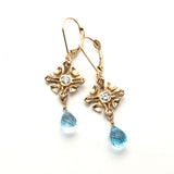 Handmade Gold lever-back earrings, sculpted square design accented with diamonds, faceted sky blue topaz drop