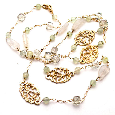 Elegant 36 inch gold necklace, hand-carved open filigree ovals scattered between Serpentine, moonstone, green amethyst