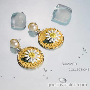 White Daisy design earrings