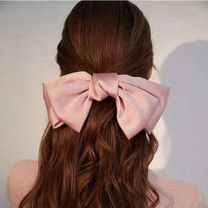 Large hairpin with bow design.