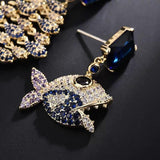 Personality 'big fish eat small fish' asymmetric earrings