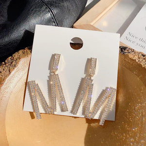 Letter M design earrings