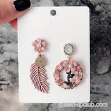 Decorative drop earrings with floral pattern of leaves