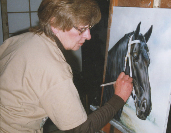 Verdayle Forget Painting in Her Studio