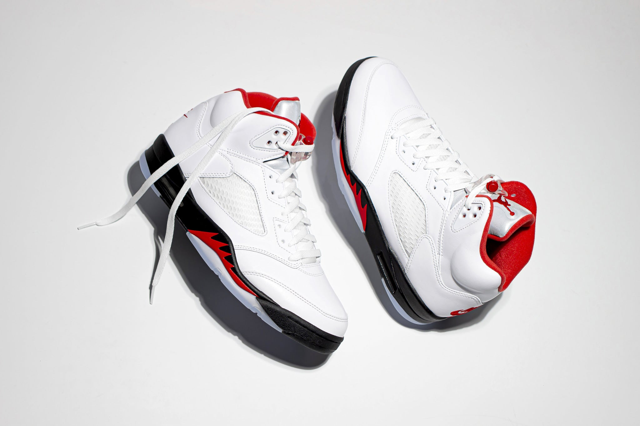 Profile view of Jordan 5 Retro Fire Red 2020 hi top sneaker