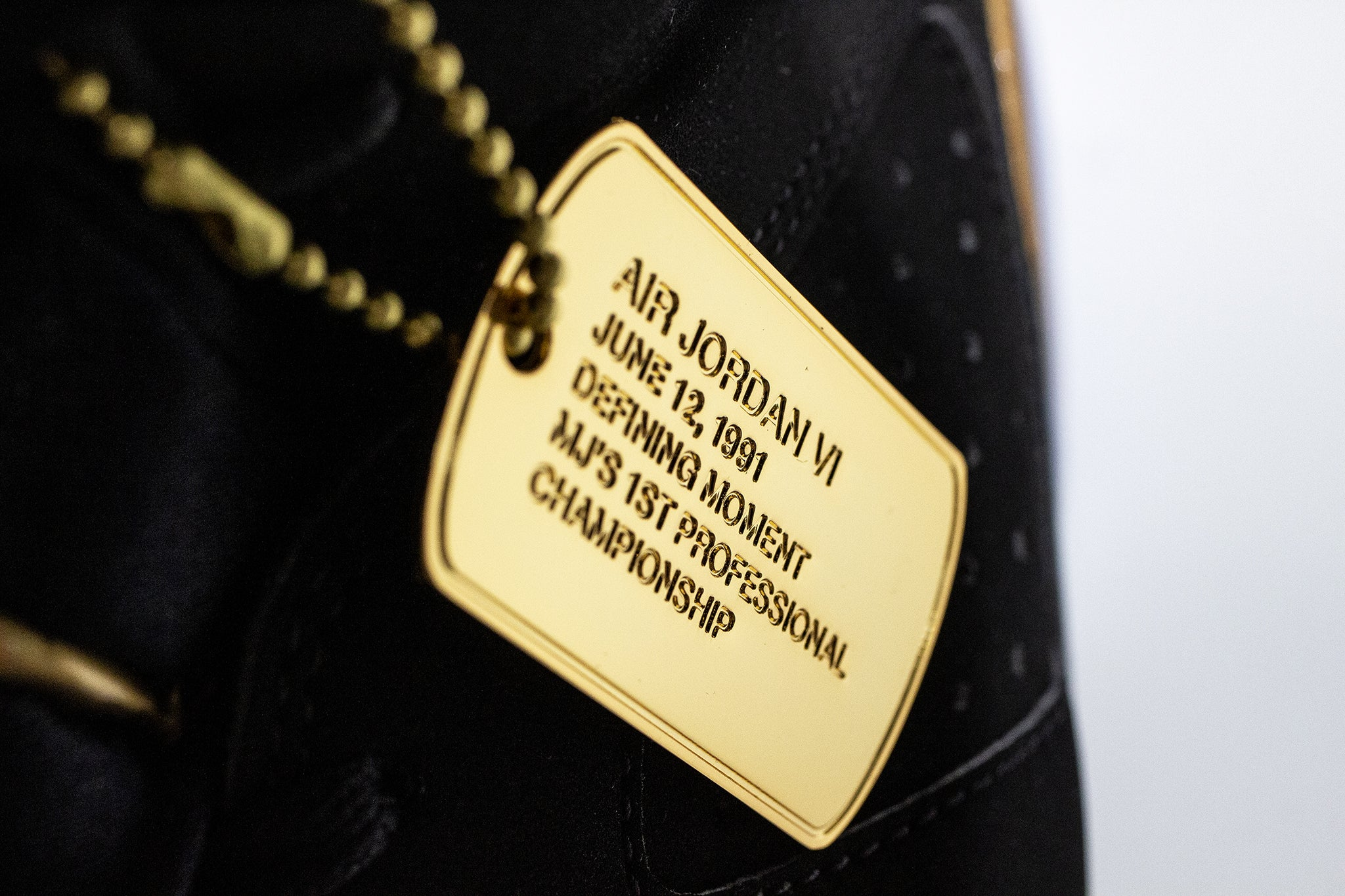 Gold dog tag with defining moments write up