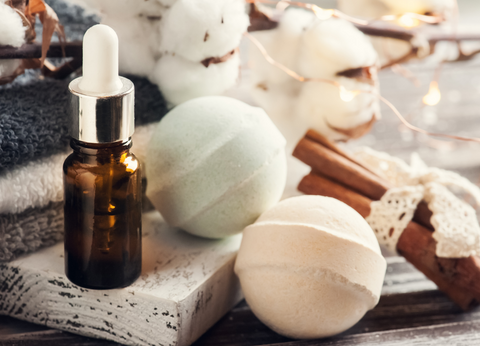 A bottle of CBD oil and the CBD bath bombs that can be made with it.