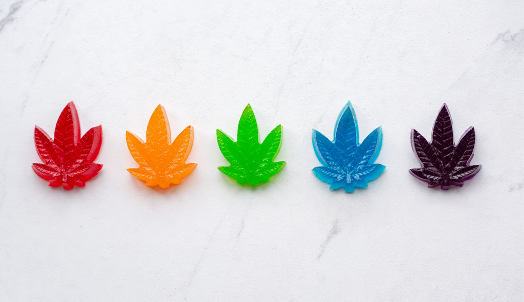 A row of rainbow colored Delta-8-THC edibles