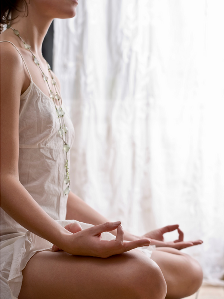 A woman meditating after work to relax