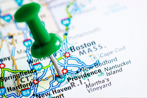 A map with a push pin marking Rhode Island