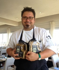 Executive Sous Chef Larry Monaco, of The Huntley Penthouse Restaurant in Los Angeles, enjoying ARO Pistachios.