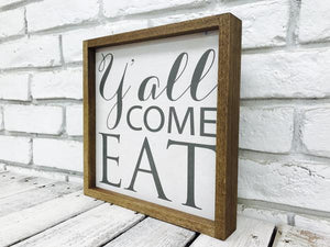 """Y'all Come Eat"" Wooden Farmhouse Decor Sign in White Distressed or Walnut Frame"