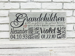 Grandchildren fill a place in your heart important dates wood sign