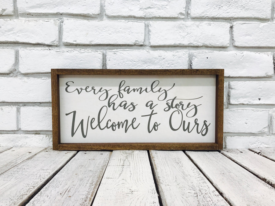 """Every Family Has a Story Welcome to Ours"" Wooden Sign"