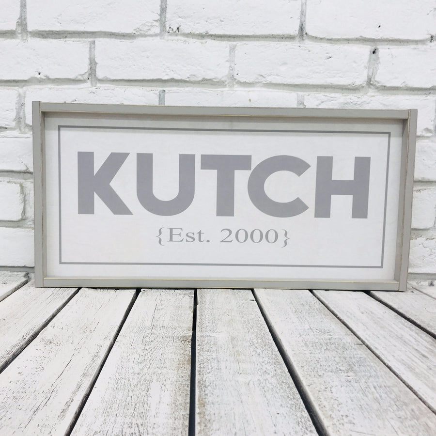 Personalized last name wood sign with distressed wood frame