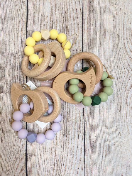 Wood and silicone baby teether and rattle