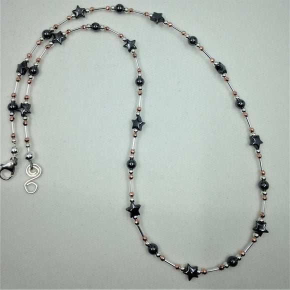 Silver and haematite star necklace.