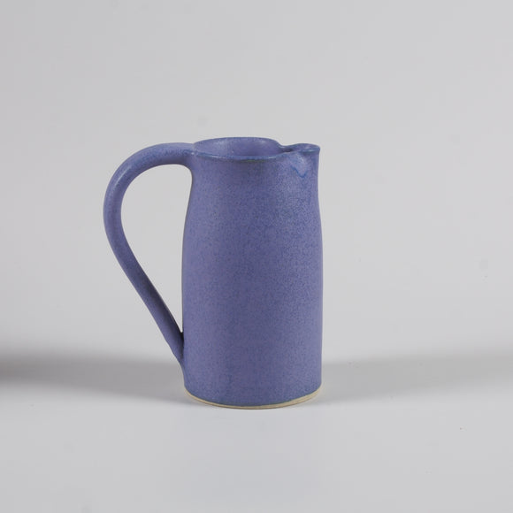 Handmade pottery jug in purple matte glaze
