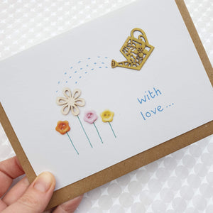 Garden flowers with watering can Card