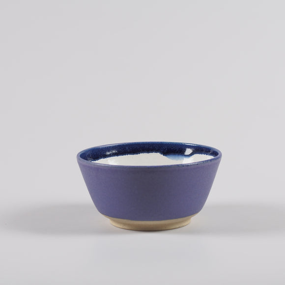 Handmade pottery breakfast bowl in purple and white
