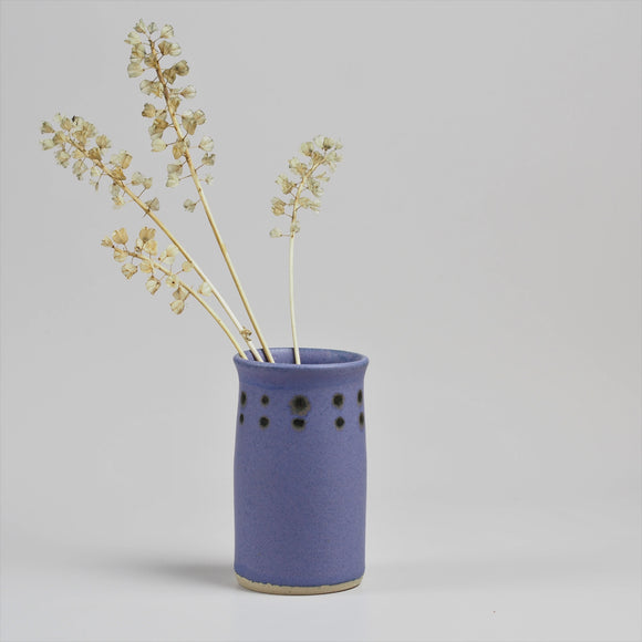 Handmade pottery posy vase in matte purple glaze with dot decoration