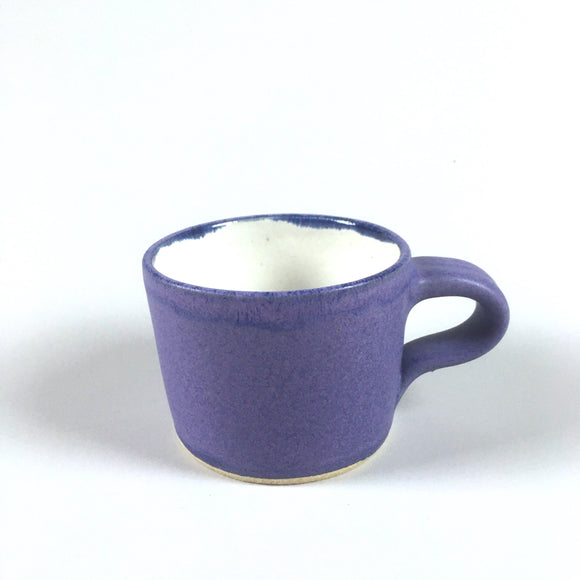 Handmade pottery mug in purple matte glaze