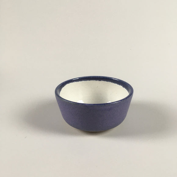 Handmade pottery dip bowl in purple and white