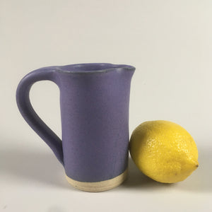 Handmade pottery cream jug in purple matte glaze