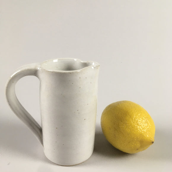 Handmade pottery cream jug in shiny white glaze