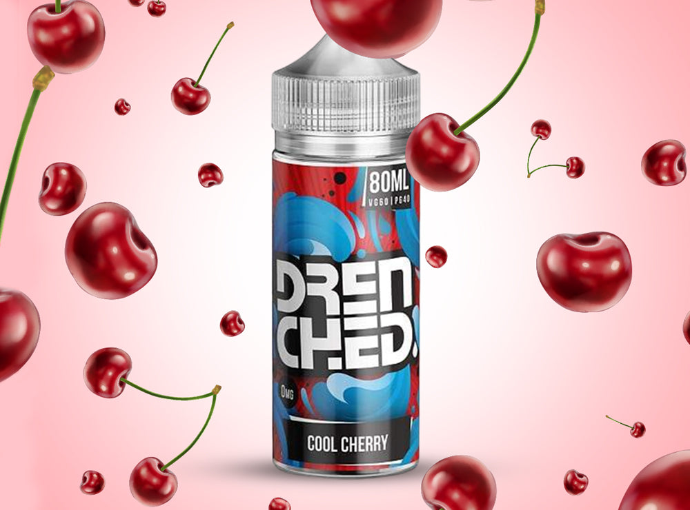 Bottle of Drenched shortfill e-liquid surrounded by cherries