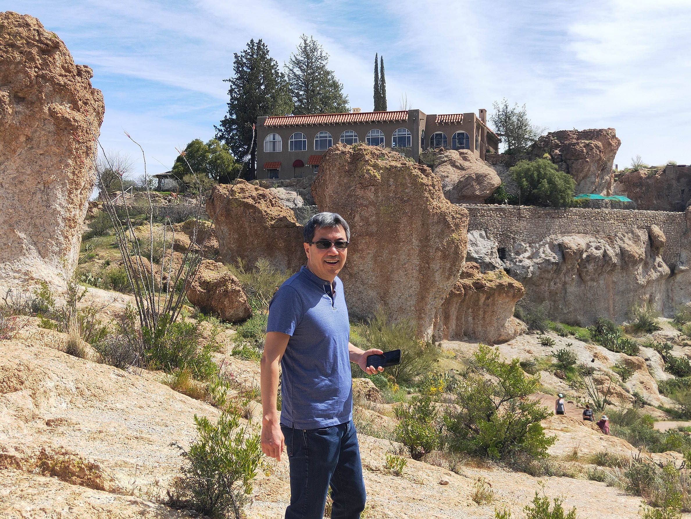 Dirty Labs co-founder Dr. Pete walks in front of rock formations at the Boyce Thompson Arboretum in Arizona.