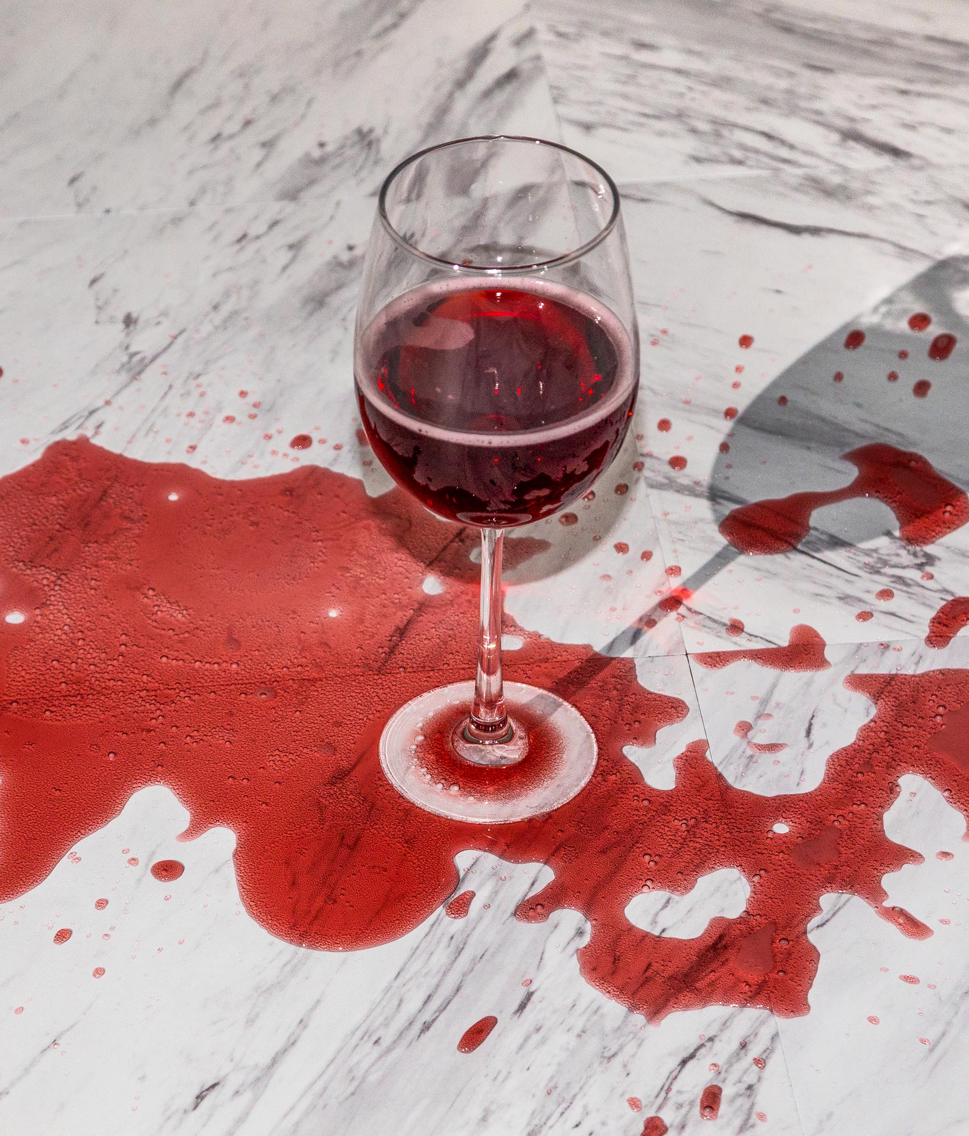 Red wine spilled over glass.