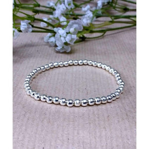 Silver Plated 5mm beaded bracelet. Handmade high quality silver plated beads threaded onto jewellers - Off The Wall Accessories