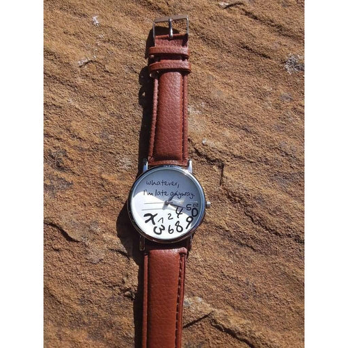 Watch that is Fun and Funky. Warm brown strap, white face, silver tone. Numbers 'fallen' with slogan - Off The Wall Accessories