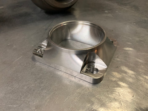 "T4 Billet Stainless to 3.00"" tube adapter."